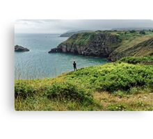 A man looking at the sea at Bery Head, Devon Canvas Print