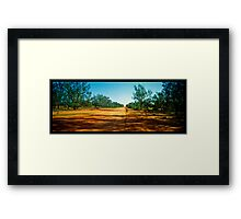 the long red road out of town Framed Print