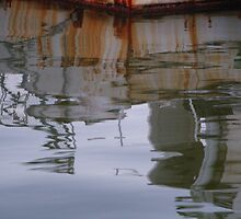 Reflections of an old fishing boat by tooky