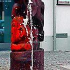 Village fountain splash capture | architectural photography by Patrick Jobst