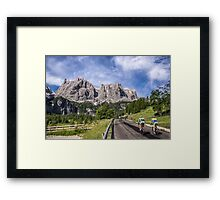 Cycling on a mountain road Framed Print