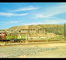 little red railway carriage and slag heap... by Juilee  Pryor