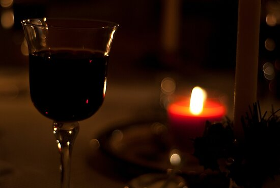 A Glass of Red wine in candle-light. by Billlee