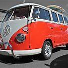 Orange Volkswagen Kombi with surfboard. by Ferenghi