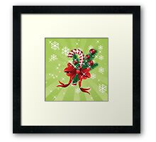 Holiday background with candy cane and bow Framed Print