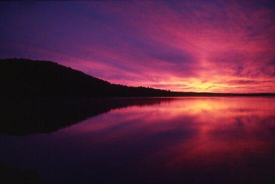 Fiery Sunrise over Thumb Lake, Michigan by John Carpenter