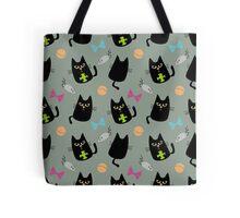 Black cat playing Tote Bag