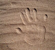 Handprint in sand by Kady