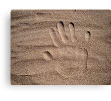 Handprint in sand Canvas Print