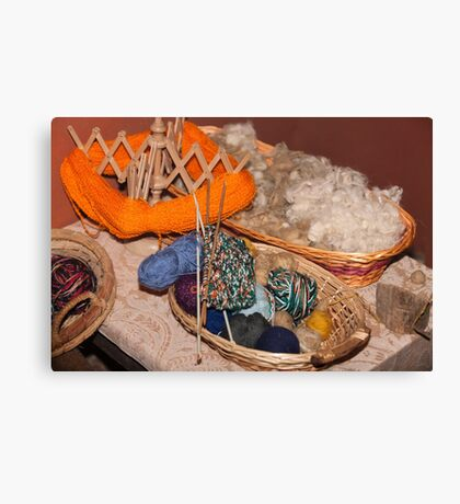 balls of wool in the basket Canvas Print