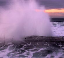 Sunrise with a Splash at the Bogey Hole by Paul Lamble