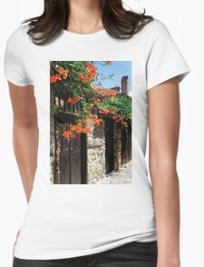 Flowers stretching out over the gates of an old house in Nessebar, Bulgaria Womens Fitted T-Shirt