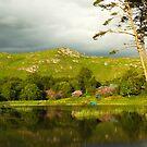 Late evening stillness at Lochan Dubh near Lochailort. by John Cameron