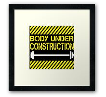 Body under construction Framed Print
