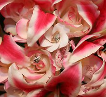 Flowers with Wedding rings by Hunnie