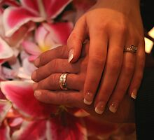 Hands crossed with wedding rings by Hunnie