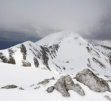 The Devils ridge in the Ring of Steall leading to Sgurr a Mhaim. by John Cameron