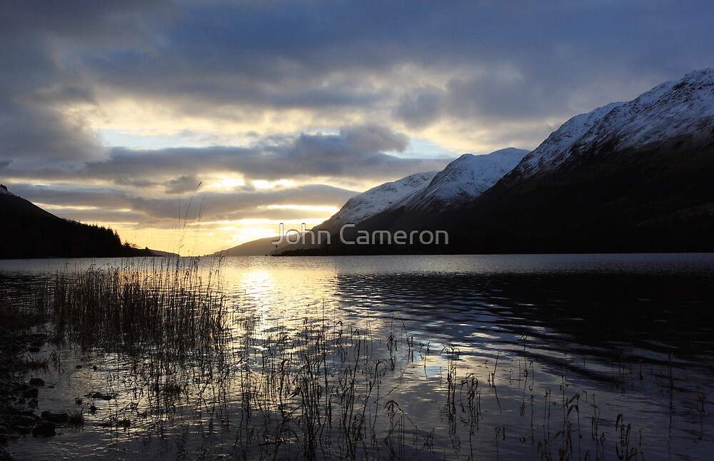 Winter Sunset over Loch Lochy. by John Cameron