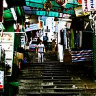 A back street in Hong Kong by James Hughes