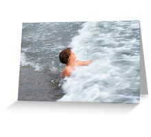 The happy boy is playing with waves Greeting Card