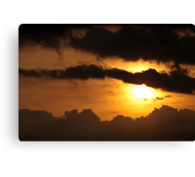 Dramatic sunset with dark clouds Canvas Print