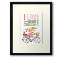 Cute rabbit riding a bike Framed Print