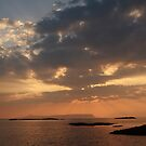 Sunset over Eigg from Arisaig. by John Cameron
