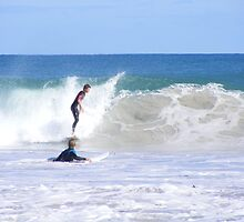 Surfer standing tall, Mullaloo by gamo