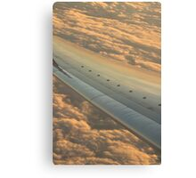Airplane flying in sky wing in flight photo Canvas Print