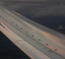Airplane flying in sky wing in flight photograph by edwardolive