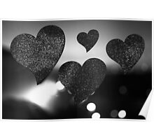 Four love hearts in silhouette night bokeh dof photo Poster