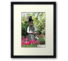 A Colonial Lady in Her Garden Framed Print