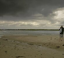 friend taking a picture at portmarnock by mtechnik