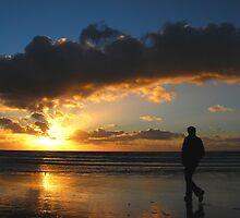 Walking towards the seaside sunset by jchanders