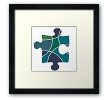 Peacock coloured puzzle piece Framed Print