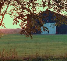 barn with sunset by donna.k. nolan