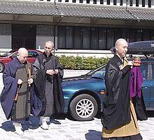 Old meets new at Sengakuji Temple, Tokyo by satsumagirl