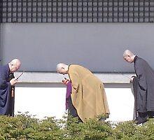 Monks bowing, Sengakuji Temple, Tokyo by satsumagirl