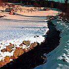 Black stream in winter wonderland   landscape photography by Patrick Jobst