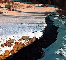 Black stream in winter wonderland | landscape photography by Patrick Jobst