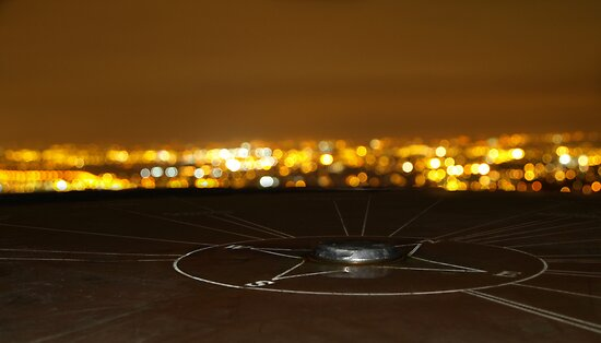 Compass Monument Overlooking Manchester at Night by Rob Davies