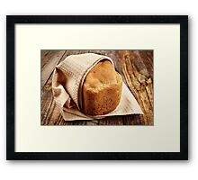 Homemade bread on a wooden board Framed Print