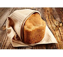 Homemade bread on a wooden board Photographic Print