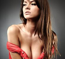 Beautiful woman with deep cleavage on gray background by naturalis