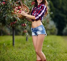 Beautiful woman picking apples by naturalis