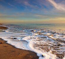 Sea foam at the beach by Sarah Vilar