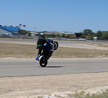 motorcyle stunts by Diana Sutton