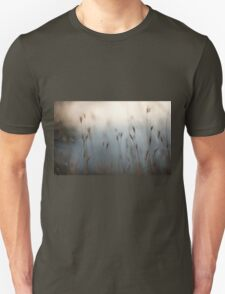 Selective focus on a plant in a wild field  T-Shirt