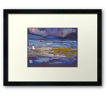 Woman on a beach Framed Print