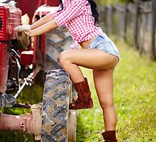 Sexy farmer girl in hat near the tractor by naturalis